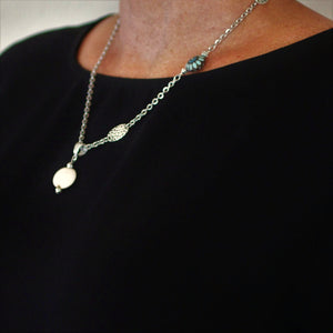 Cream Golem Pendant Necklace with Teal Flowers Bead and Silver Hammered Connectors