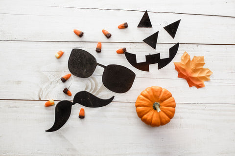 Mustache and glasses pieces, and jack-o-lantern pieces with fall decor.