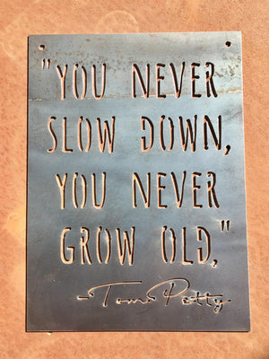 "You Never Slow Down, You Never Grow Old."" -Tom Petty Small Rectangular Metal Sign"