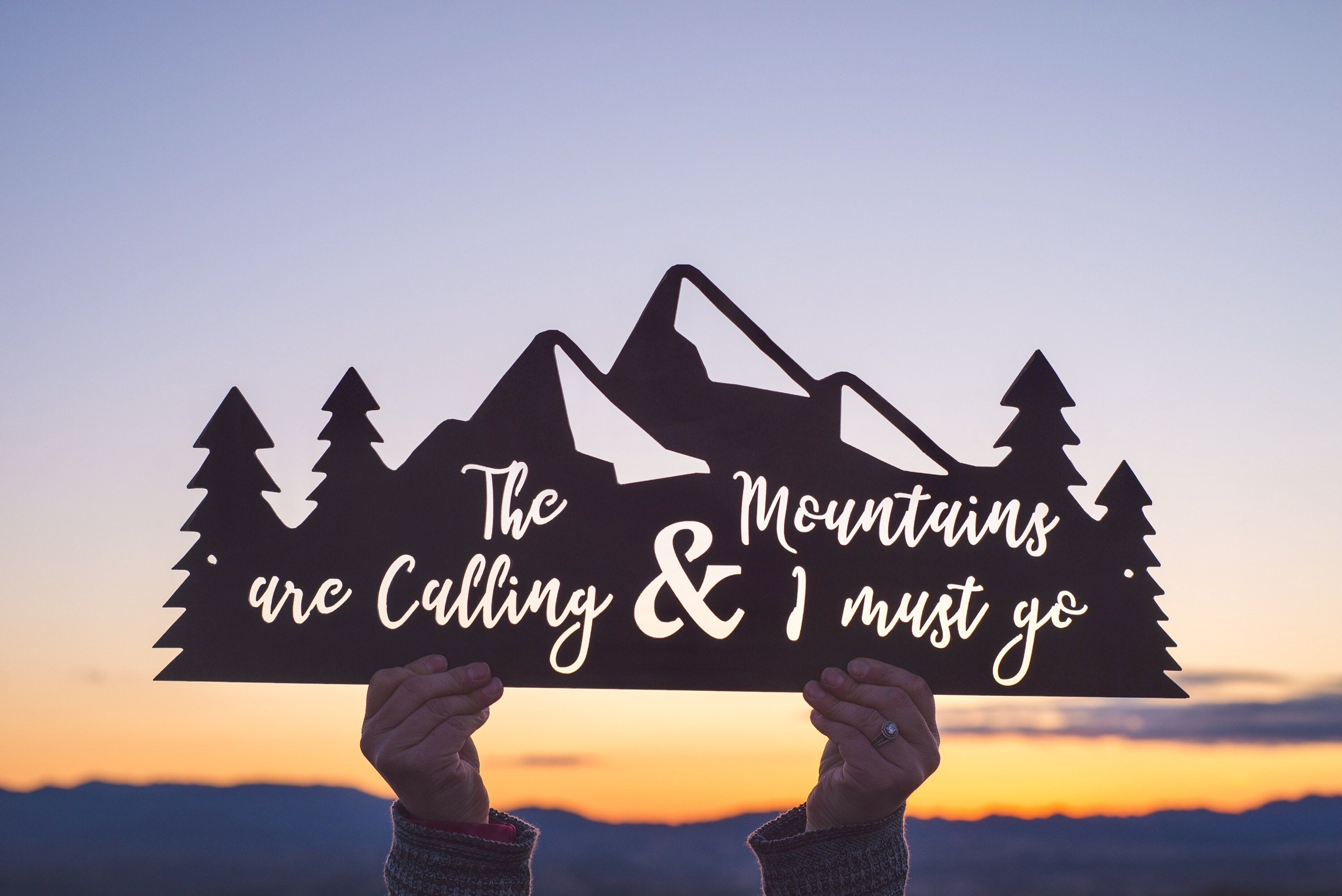 The Mountains Are Calling & I Must Go metal sign