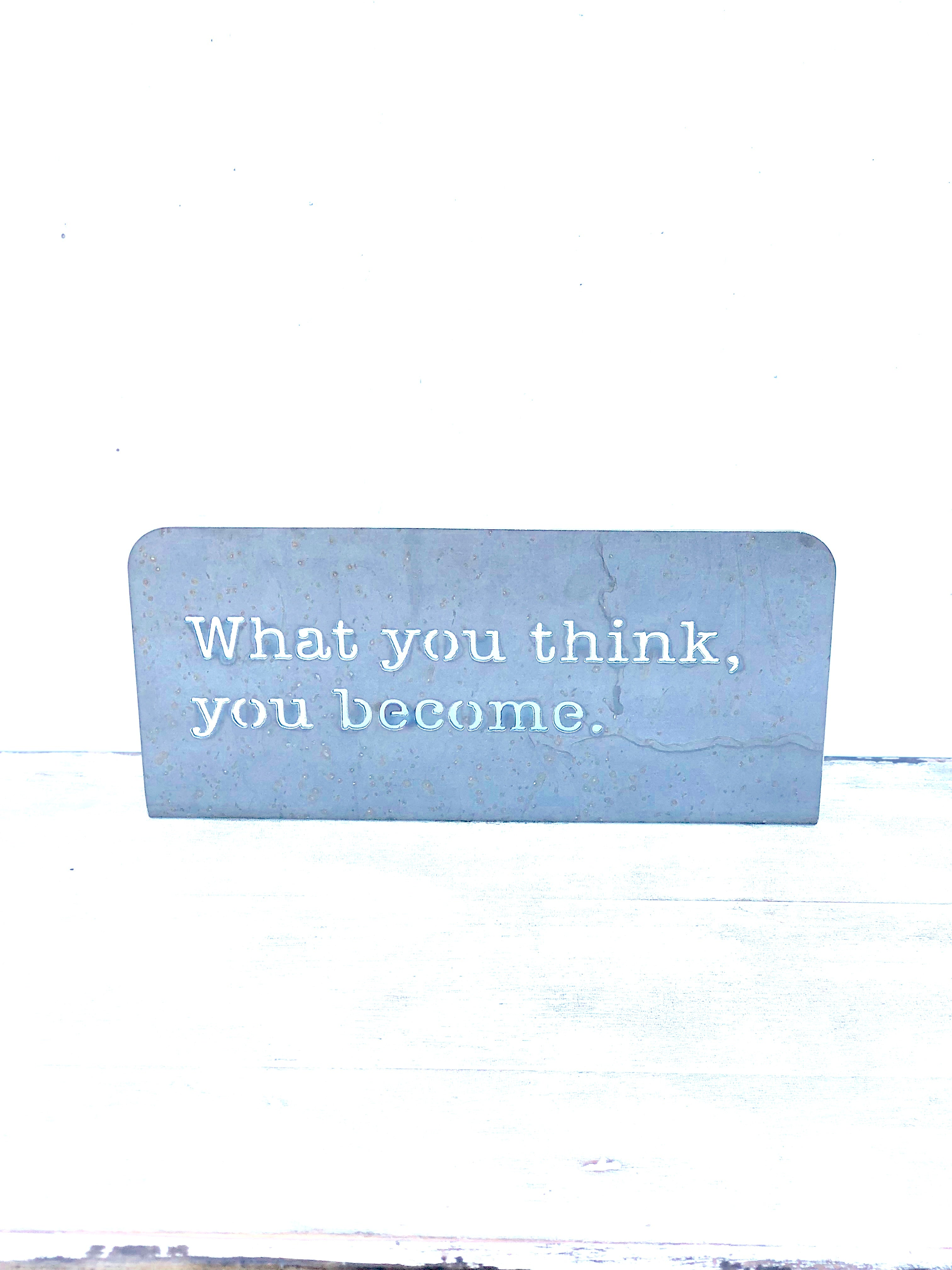 What you think, you become Standing metal mindfulness sign
