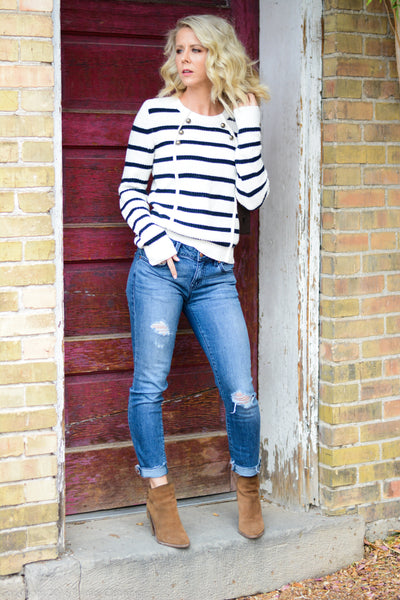 Striped button front sweater with denim jeans