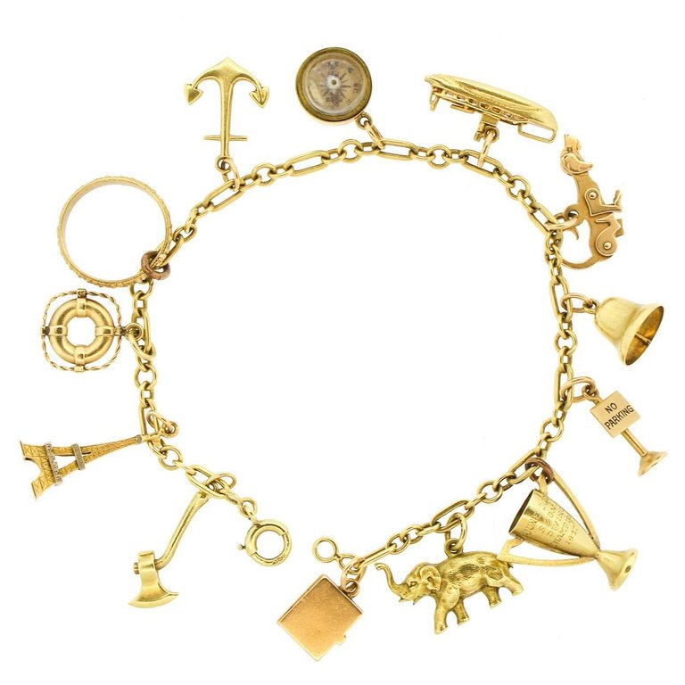 Whimsical 14 Karat Yellow Gold Charm Bracelet