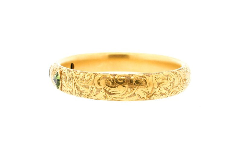 Art Nouveau Engraved 14 Karat Gold Peridot Hollow Form Bangle Bracelet