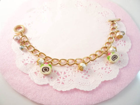 Gold Swiss Roll Charm Bracelet
