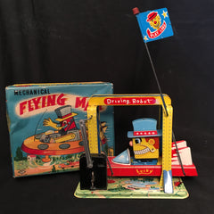 Vintage Mechanical Flying Man Driving Robot