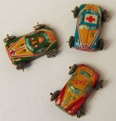 Vintage Tin Penny Toy Ambulance, G Man Car, and Yellow Taxi Set