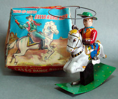Vintage Japan Tin Cowboy With Twirling Rope Wind Up