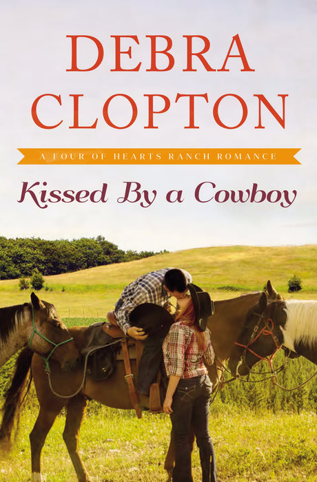 Kissed By A Cowboy (Four Of Hearts Ranch Romance)