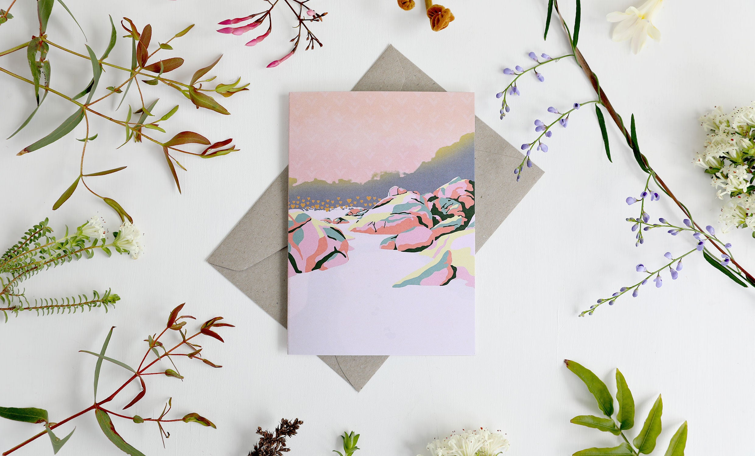 Beach abstract illustration on a recycled paper greeting card with envelope, surrounded by native Australian leaves and flowers.