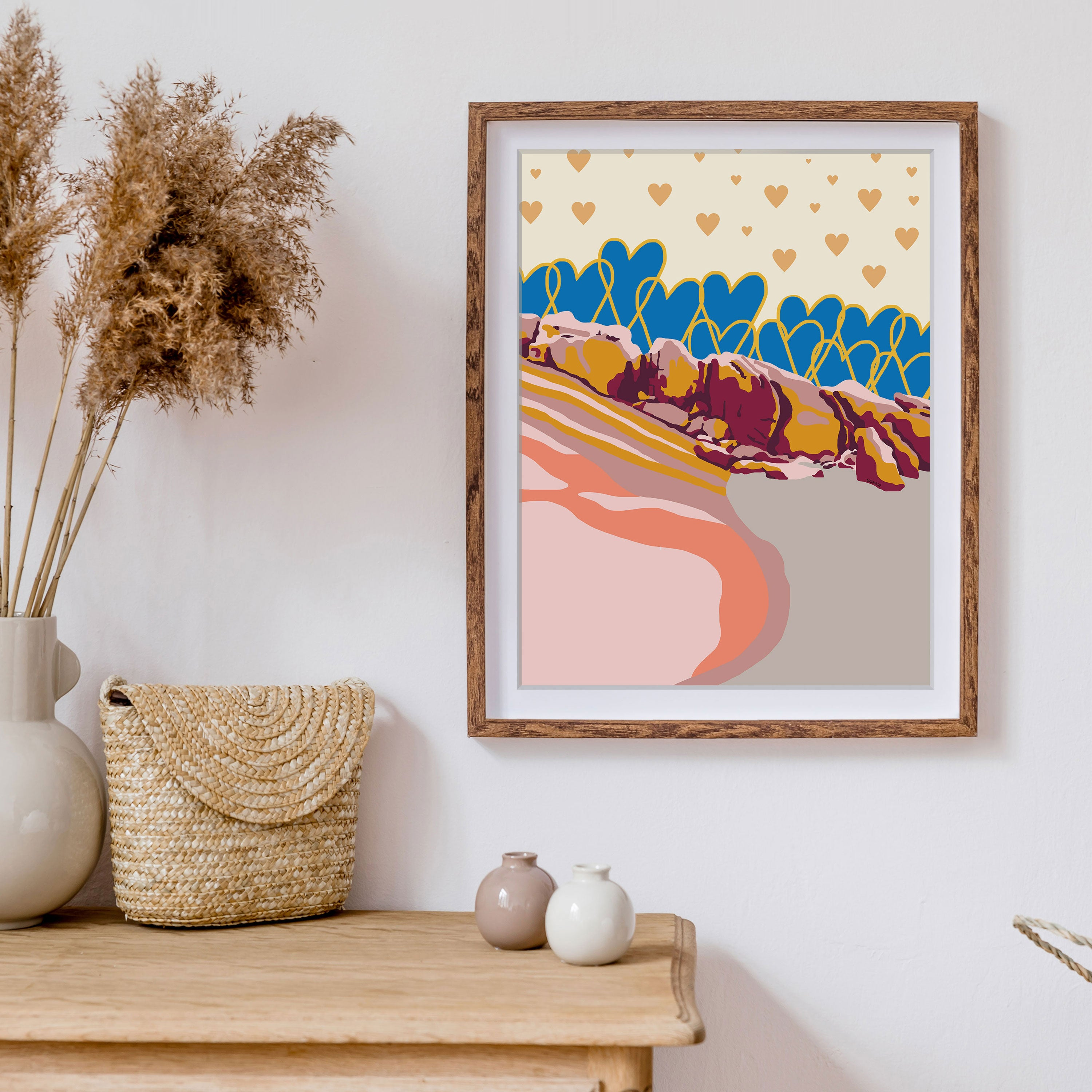 Modern beach illustration poster framed above boho natural styled cabinet