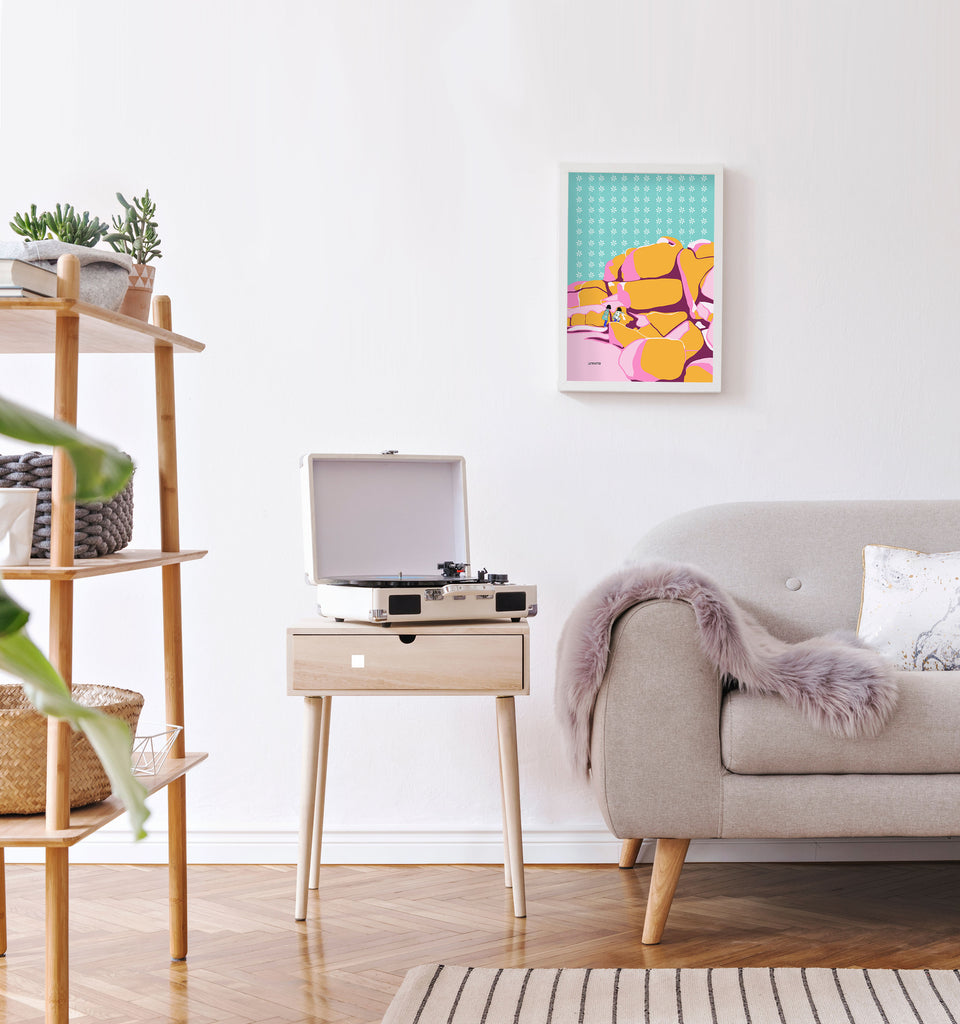 Minimal retro style living room with bright colorful kids pop art poster on wall.