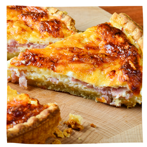 Ham and Cheese quiche on a wooden cutting board