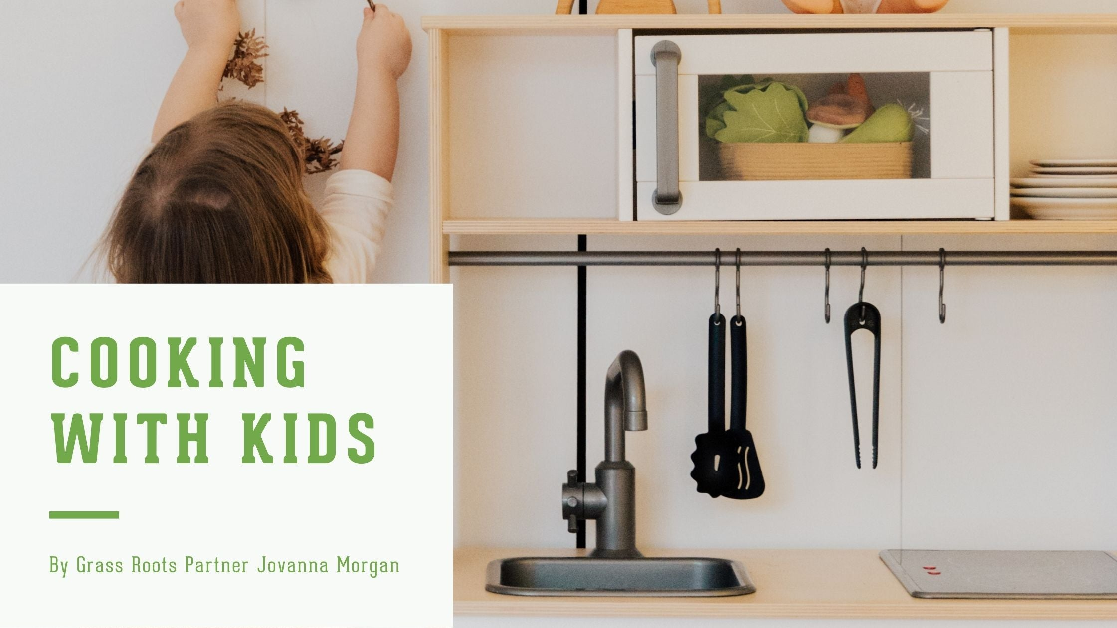 """Image of a child in a play kitchen. The words """"cooking with kids. By grass roots partner Jovanna Morgan"""" on the left side"""