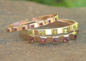 Wide Spring Gold Bangle with Pyramid Cabochons
