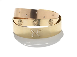 Spring Gold Bracelet with Amulets and Diamonds (amulet bracelet shown center)