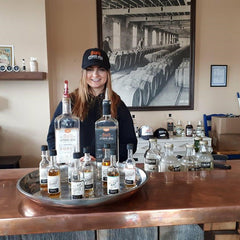 Nicole serving bar at Top Shelf Distillers