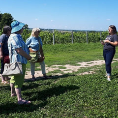KIN Vineyard sommelier Alex Britton and La Vida Local food and wine tour guests