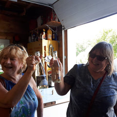 La Vida Local food and wine tour guests toast new-found friends at Farmgate Cider
