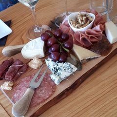 La Vida Local food and wine tour guests enjoy a charcuterie board at Kin Vineyards.