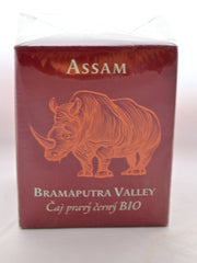 "The Assam Brahmaputra box is a squat, red cube with an orange rhino on the front. White text reads: ""Assam. Brahmaputra Valley."" Czech lettering is below the English writing."