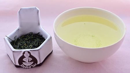 A side-by-side comparison of Gyokuro leaves and steeped tea. On the left, the leaves are long and needle-like, with a rich dark green color. On the right, the steeped tea is a pale green.
