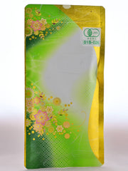 The plastic Kabusecha  packet is green and gold, with pink and gold flowers decorating the dark green left side. It fades up into white, and then appears to be gold-dipped on the right side. There is a lot certification sticker on the top right.