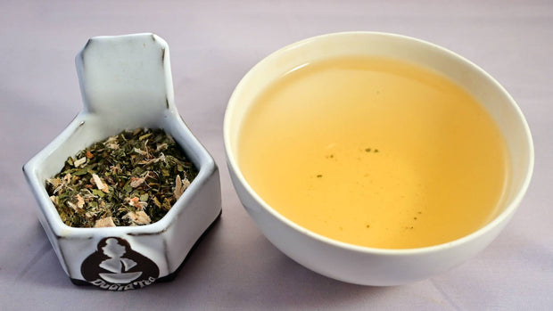 A side-by-side comparison of the Throat Juice blend and steeped tisane. On the left, the herbal blend prominently features echinacea and licorice root. On the right, the steeped tisane is a pale orange.