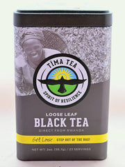 "A triangular silver tea tin holds Black Rwandan tea. At the top is an image of a tea-picker smiling into the camera with a basket on their back. In the center, a logo featuring a bird with wings spread flying upward toward the sun is surrounded by words ""Tima Tea. Spirit of Resilience."" Below, the tin features other descriptive messaging: ""Loose leaf black tea direct from Rwanda. Get loose... step out of the bag! Net weight is 2 ounces or 23 servings."""