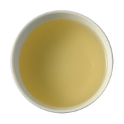 A picture of steeped Ya Bao tea face down. The tea is a creamy, soft off-white color.