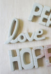 "Natural Stone ""Love"" Script Sculpture - RUST & Co."
