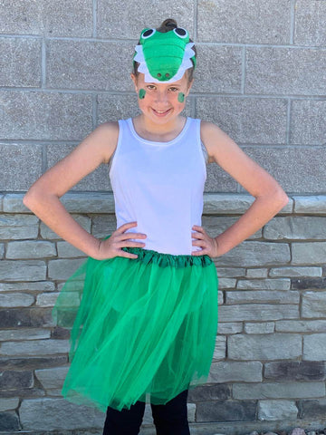Big kid girl wearing green tutu and alligator headband costume.
