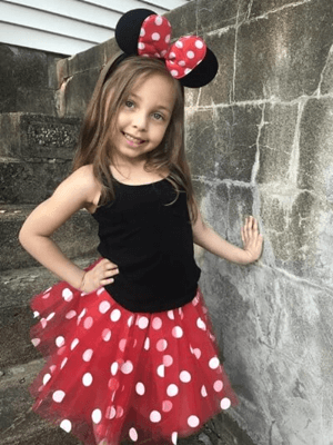 girl in red polka dot Minnie Mouse tutu costume by Sydney So Sweet