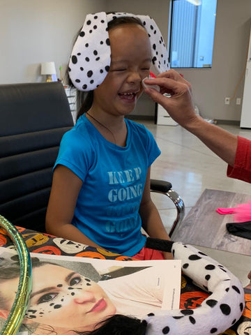 DIY dalmatian costume face paint on little girl