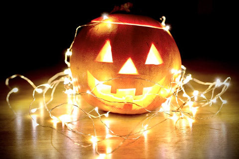 carved pumpkin accented with string lights