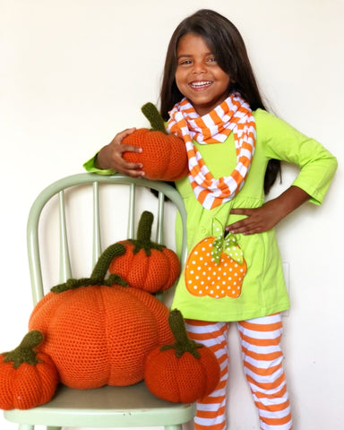 little girl in lime green pumpkin stripe 3 piece scarf outfit by Sydney So Sweet