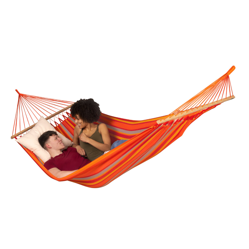 Two people relaxing in bright coloured hammock
