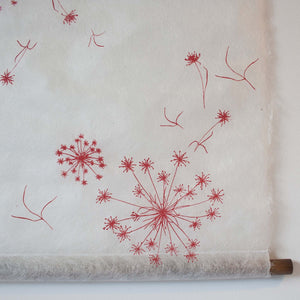 red and white silk paper wall hanging detail
