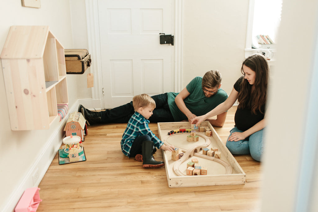 family playing on floor