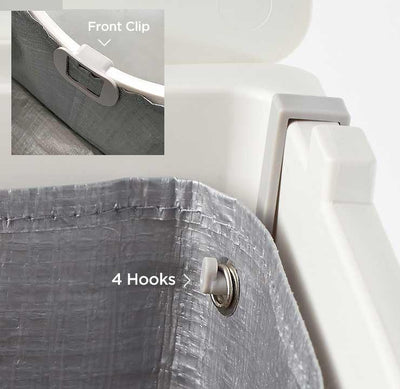 The Flip Tarp Liner is secured buy four hooks and a clip in the front.