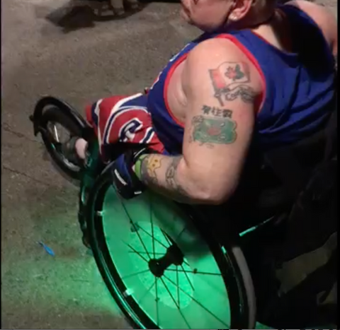 Joey at Disney World with his LED Lighting system installed on his manual wheelchair.