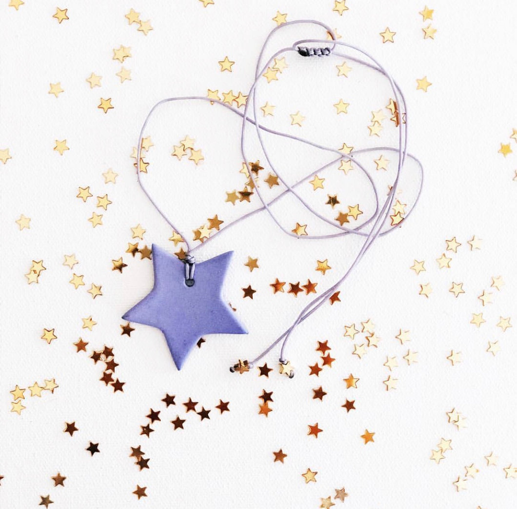 Women's lilac porcelain star on a string necklace