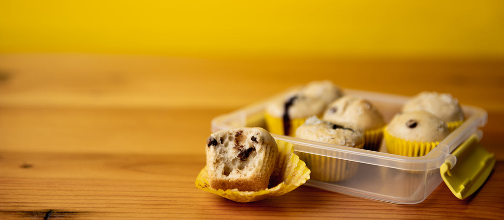 Unwrapping chocolate chip mini muffin