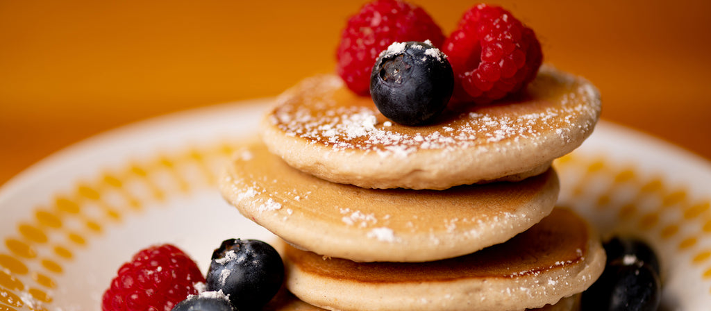 Allergy free mini pancakes with raspberries and blueberries