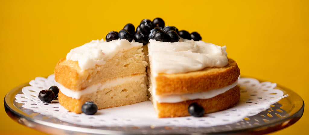 Allergy free yellow cake with blueberries and white icing