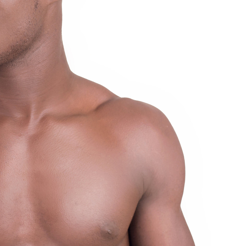 Upper body of an African American man in front of a white background