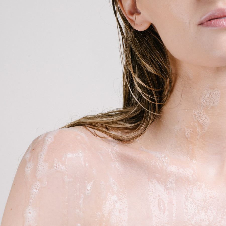 woman's shoulder covered in body wash