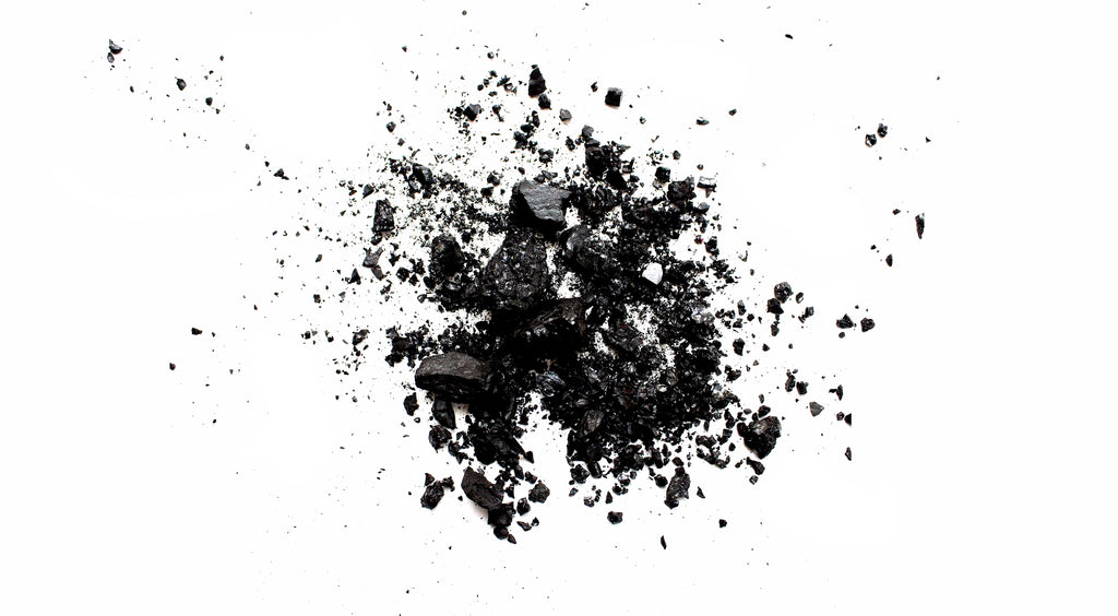 Coconut Shell Charcoal in front of white background