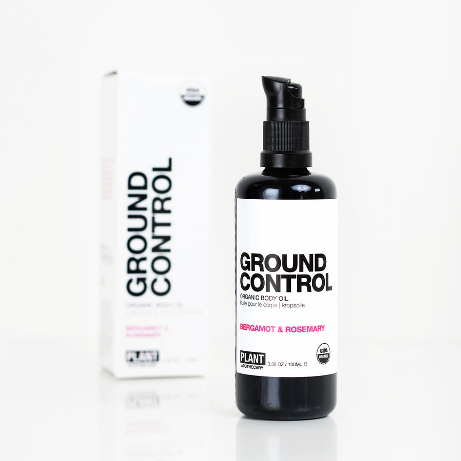 GROUND CONTROL Organic Body Oil sitting to the right of its packaging in front of white background