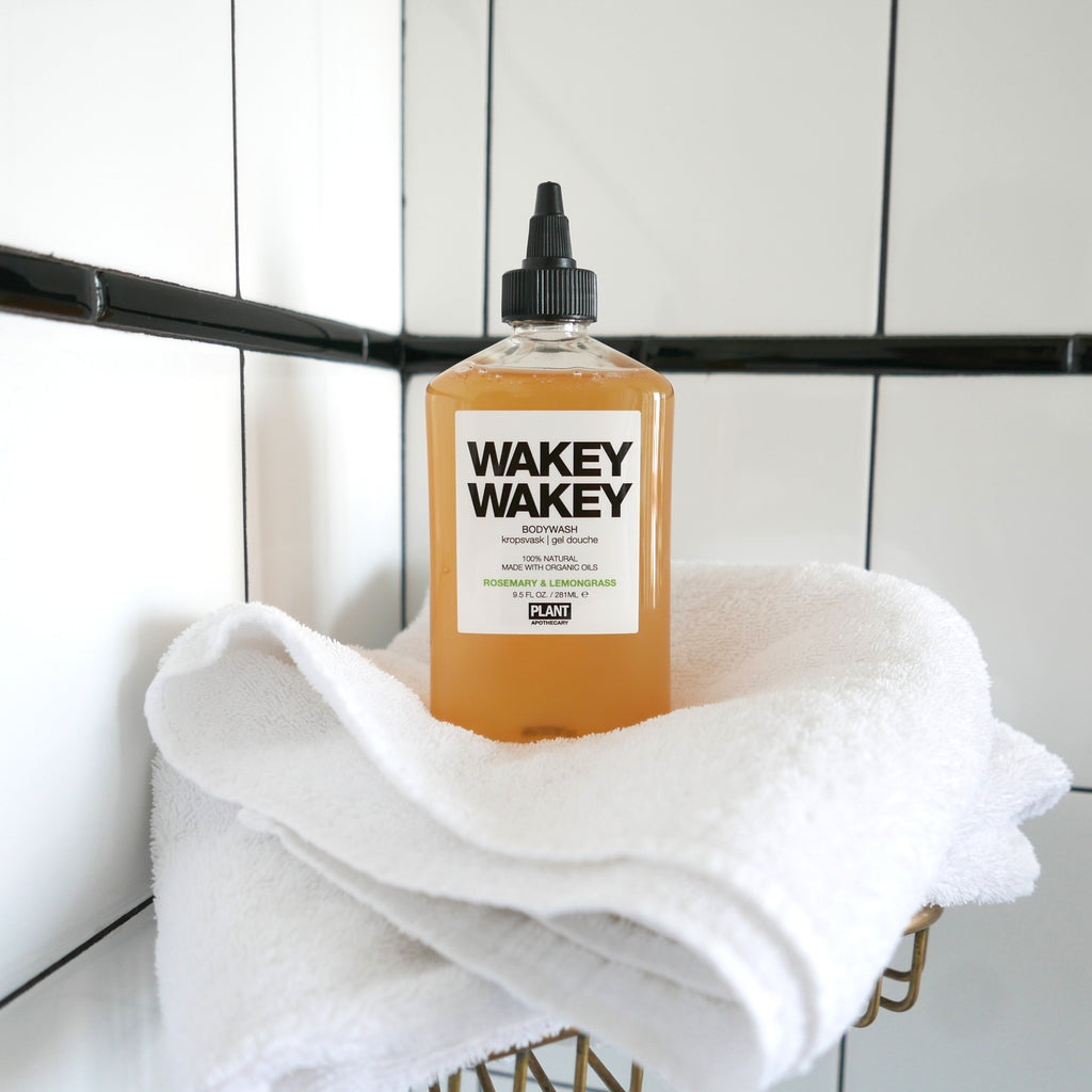 WAKEY WAKEY Organic Body Wash sitting on white towel in a shower